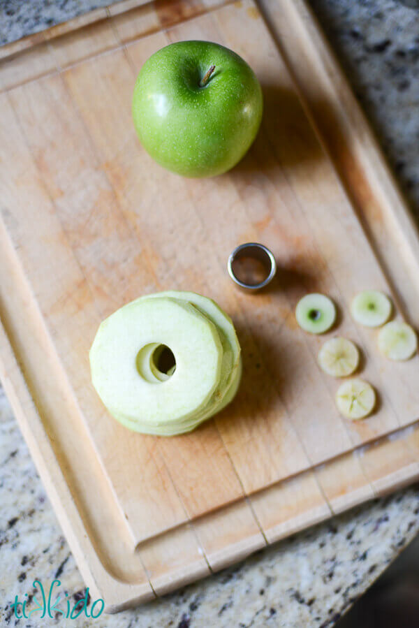 Apples cut into thin slices with the center core removed with a small, round cookie cutter.