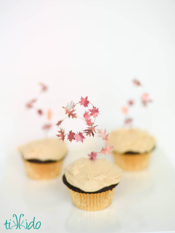 Fall leaf cupcake toppers look like leaves swirling in an autumn gust of wind.