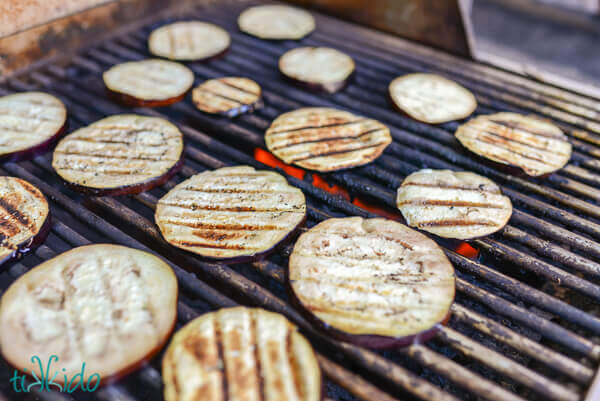 Eggplant slices on a grill.