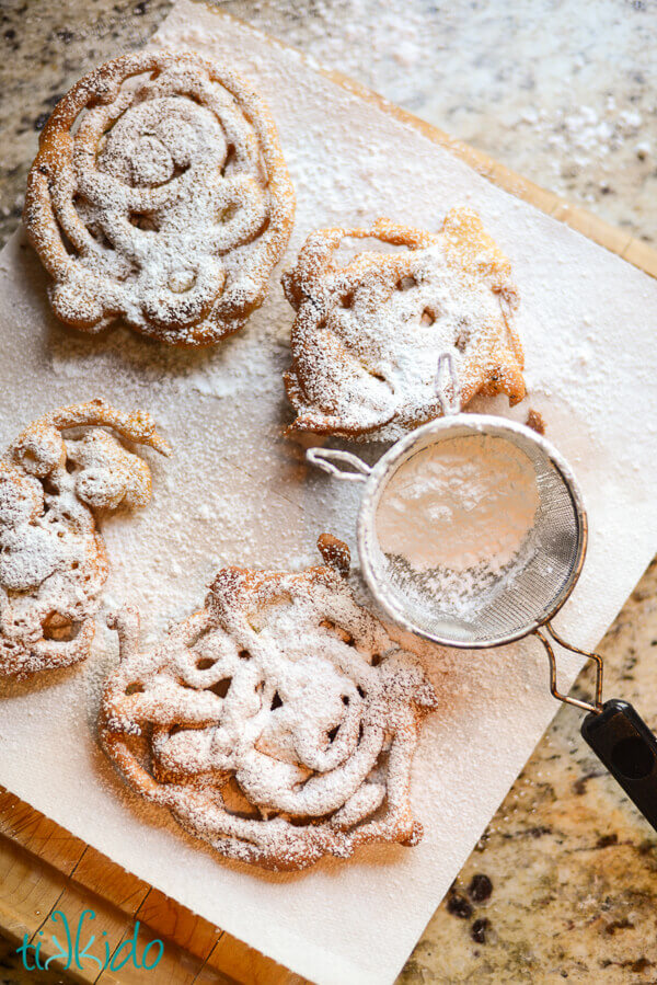 Mini funnel cakes dusted with powdered sugar.
