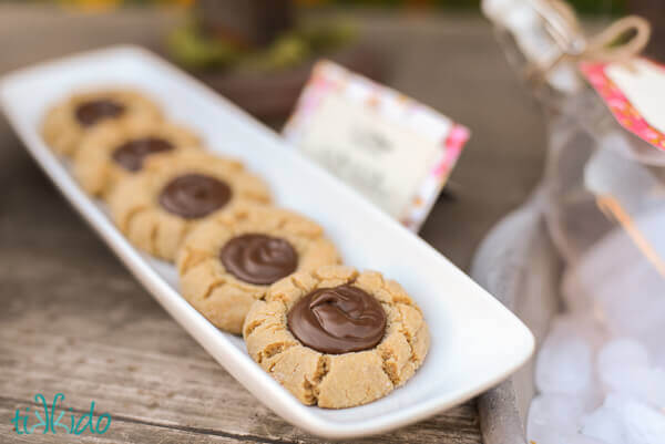 Peanut Butter Nutella Thumbprint Cookies on a white tray.