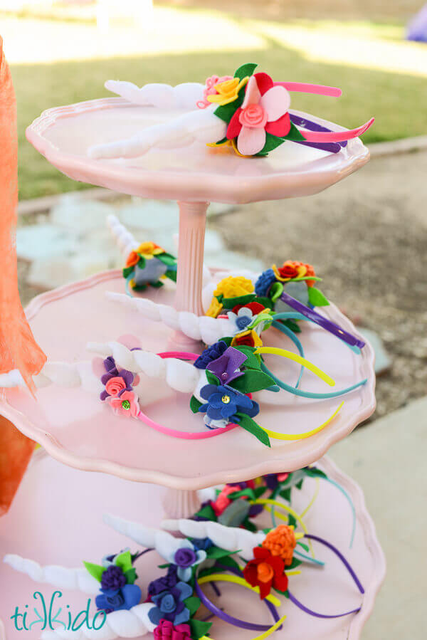 three tiered tray with numerous felt unicorn horn and flower headbands  displayed. 58a77dd0355