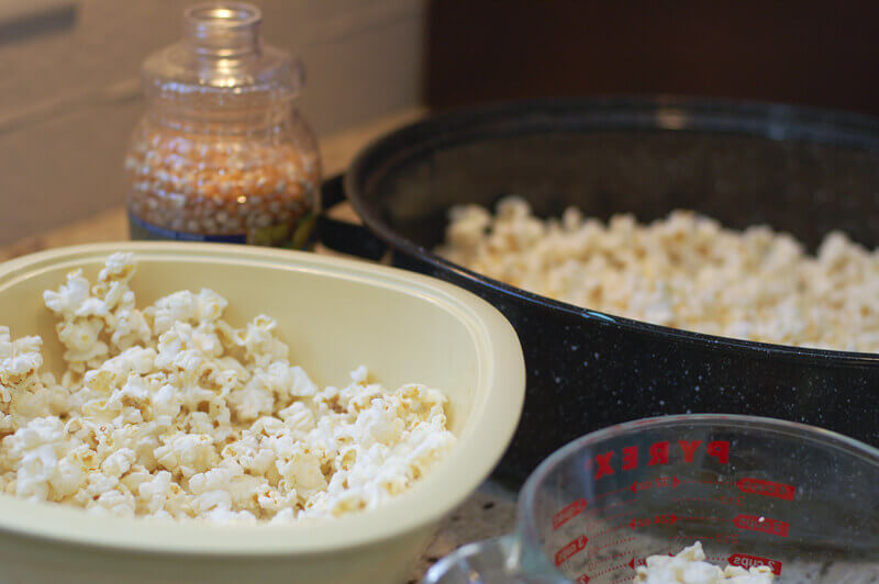 Popped popcorn in roasting pan to make bright colored candied popcorn using kool aid.