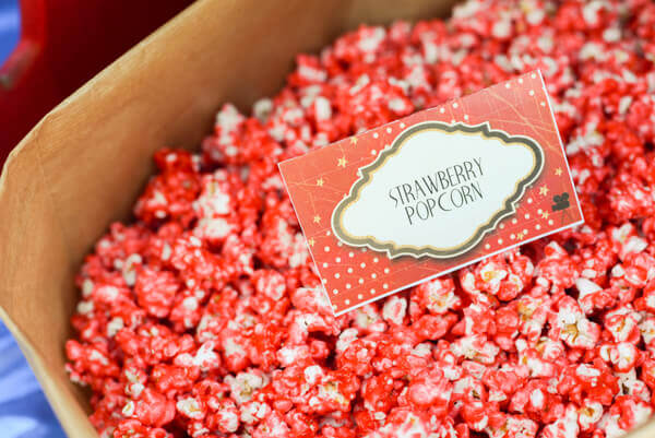 Strawberry candied popcorn made with Kookaid (Kool Aid Popcorn)