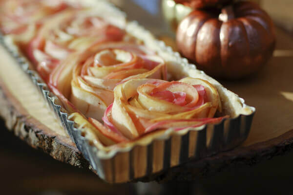 Rose apple pie made with with thinly sliced apples arranged into rose shapes.