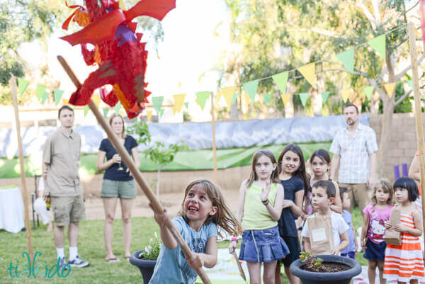 Kids hitting the Smaug piñata at the Hobbit birthday party.