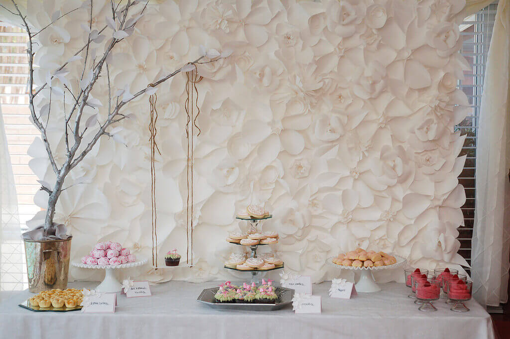 How to make a gorgeous diy paper flower backdrop for under 20 part the secret garden themed baby shower dessert table featuring a stunning giant white paper flower backdrop mightylinksfo