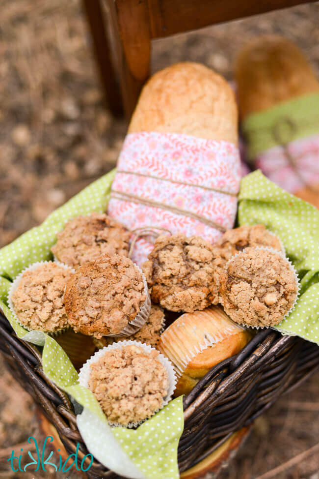 Basket full of applesauce spice muffins with crumb topping.