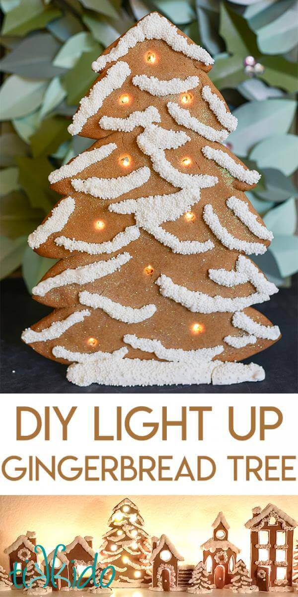 standing gingerbread christmas tree decorated with white royal icing and white sprinkles and lit up with