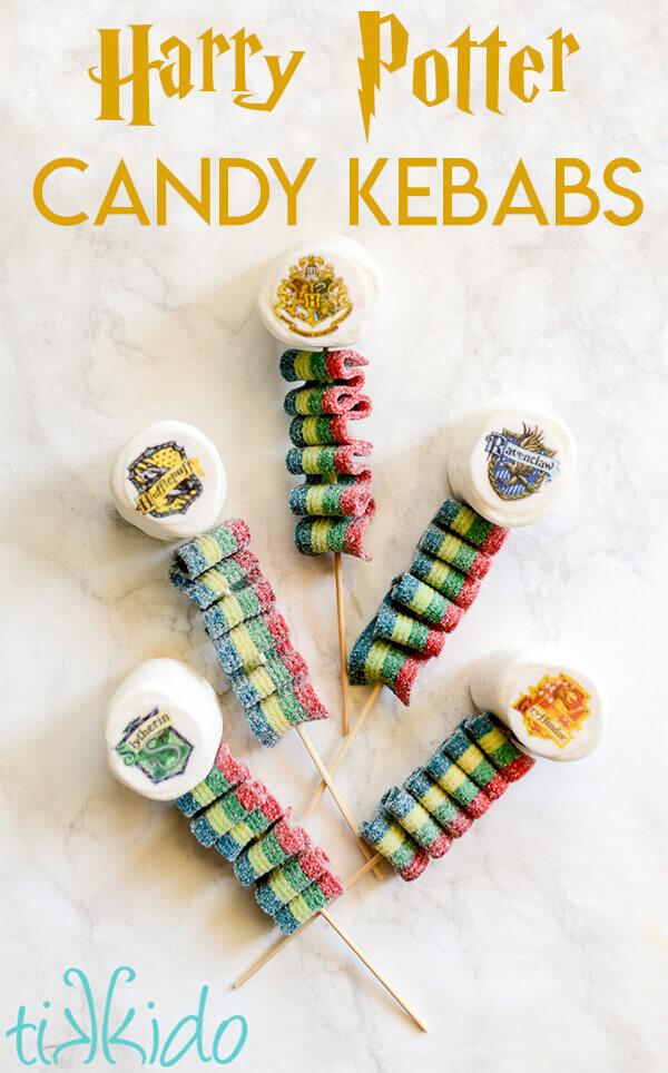 Harry Potter Candy Kebabs topped with marshmallows decorated with the Hogwarts house crests.