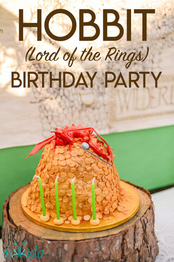 Cake that looks like Smaug on top of a horde of coins for a Lord of the Rings birthday party