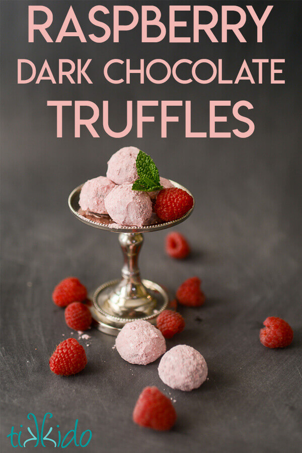 Chocolate Raspberry Truffles on a small silver stand, surrounded by fresh raspberries.