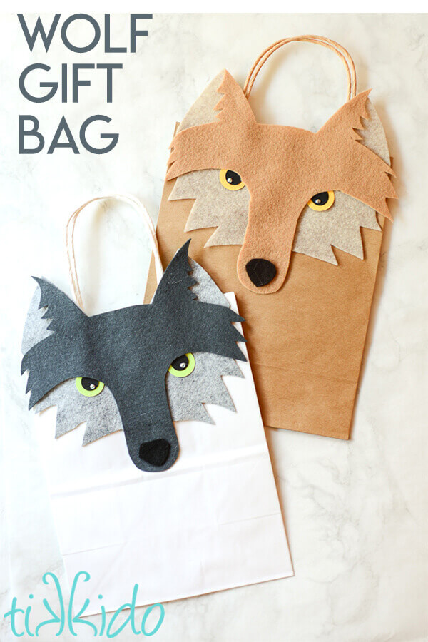 Turn a plain paper gift bag into a wolf themed gift bag with this tutorial and free printable templates.