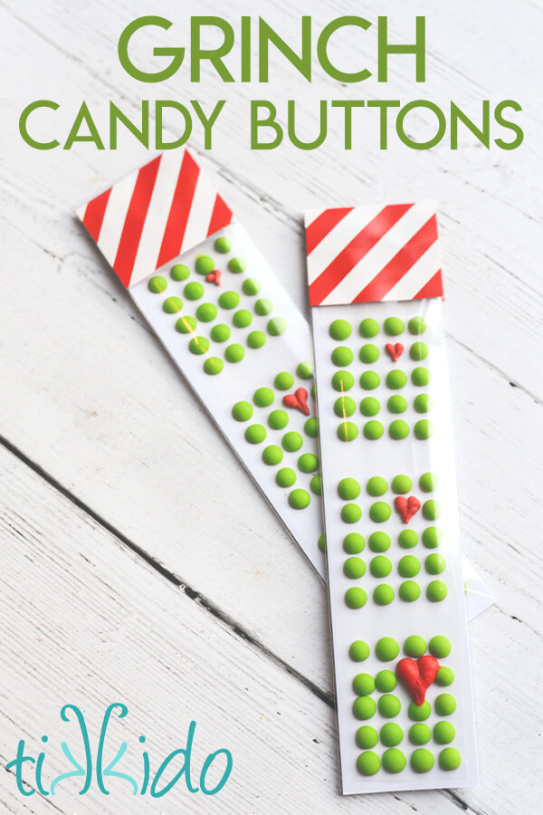 Two packages of Grinch Candy Buttons inspired by How the Grinch Stole Christmas.