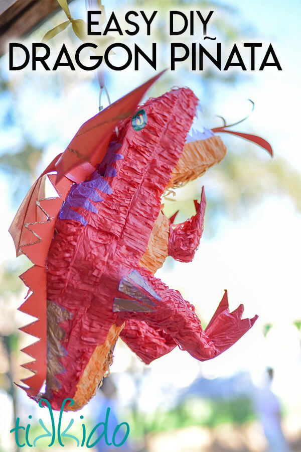 "Smaug piñata made from a store bought dinosaur piñata, with text overlay reading ""Easy DIY Dragon Piñata."""