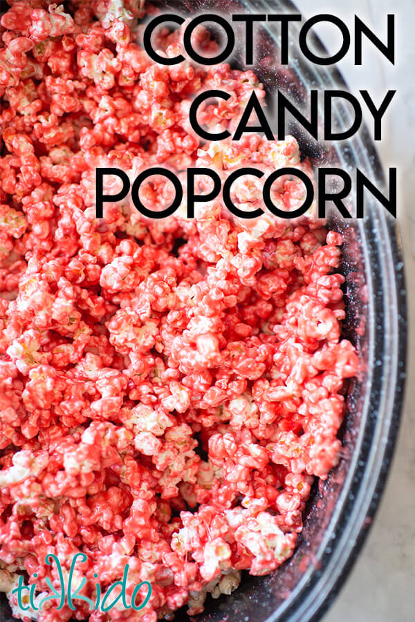 Pink cotton candy popcorn in a roasting pan.