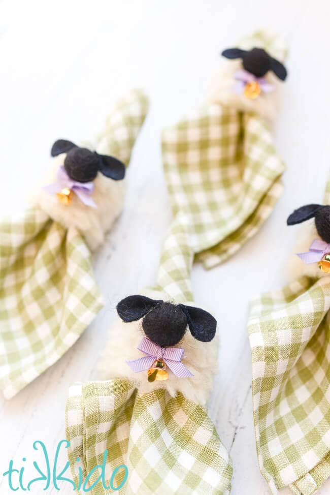Green gingham napkins with Easter napkin rings that look like sheep.