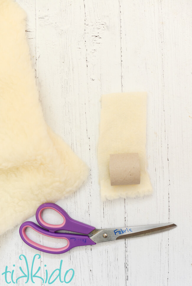 Faux shearling fabric being cut to make Easter napkin rings that look like sheep.