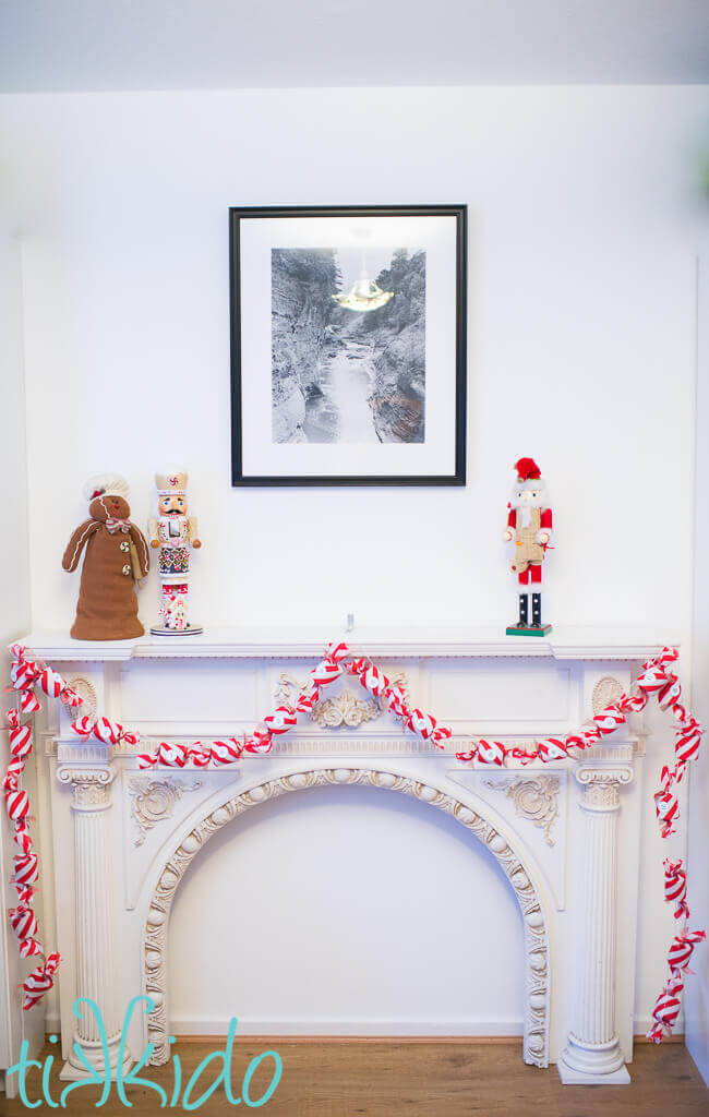 DIY Advent Calendar garland hanging on a white fireplace mantel.