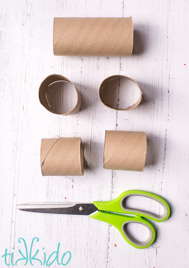 Toilet paper tubes being cut in half to make a DIY Advent Calendar