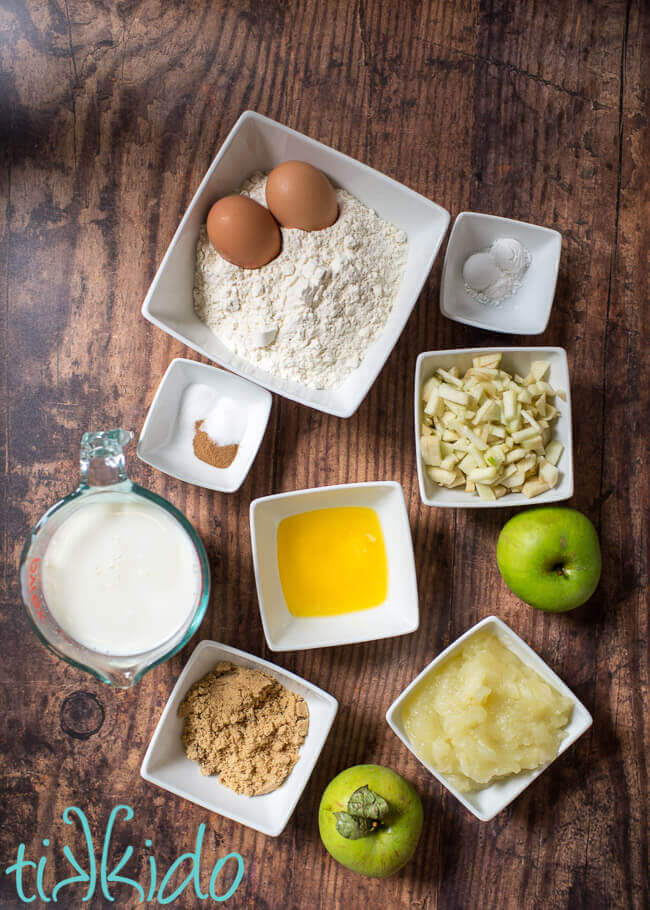 Ingredients for apple pancakes recipe on a wooden table.