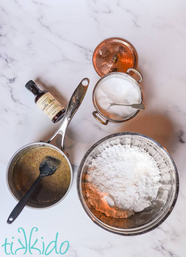 Ingredients for Browned Butter Frosting on a white marble surface.