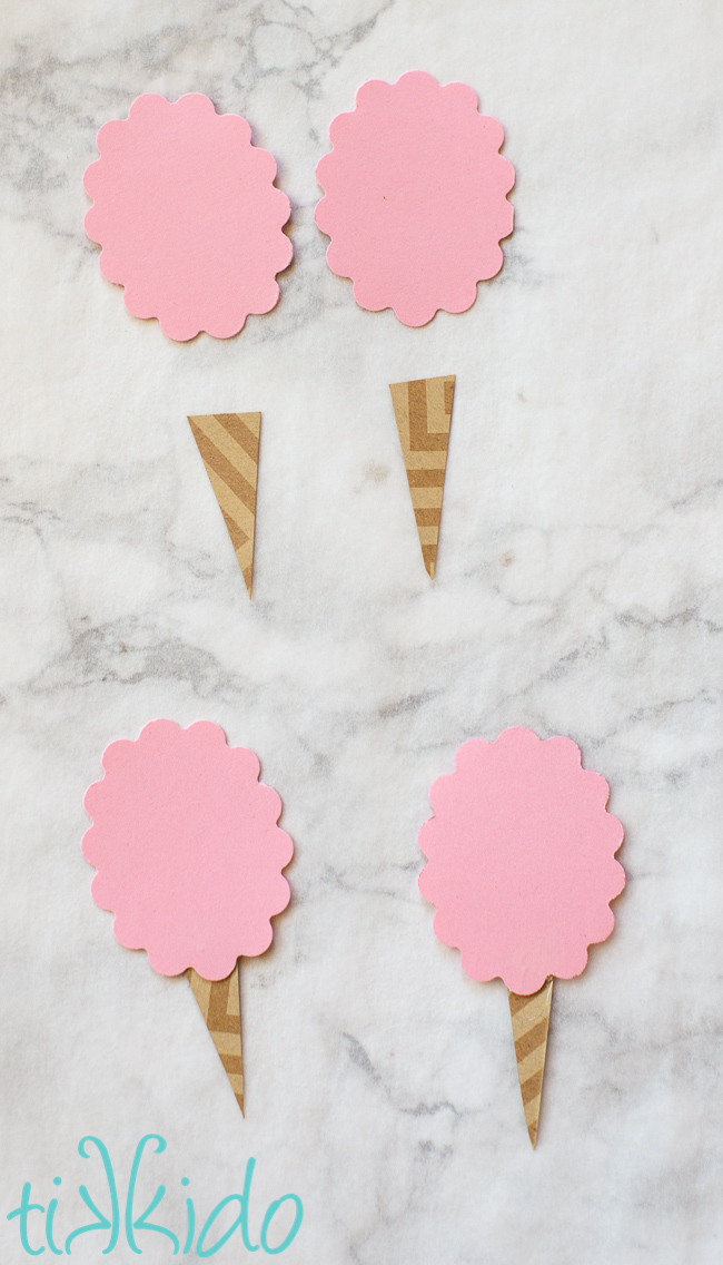 Scrapbook paper being used to make paper cotton candy embellishments.