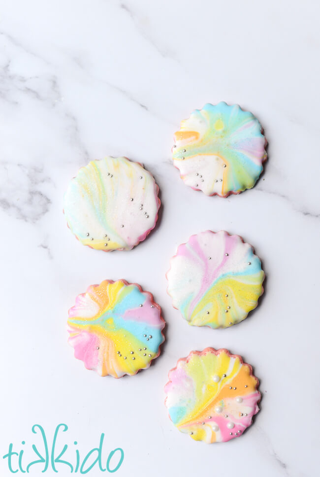 Cotton candy sugar cookies decorated with a pastel rainbow of marbleized royal icing.