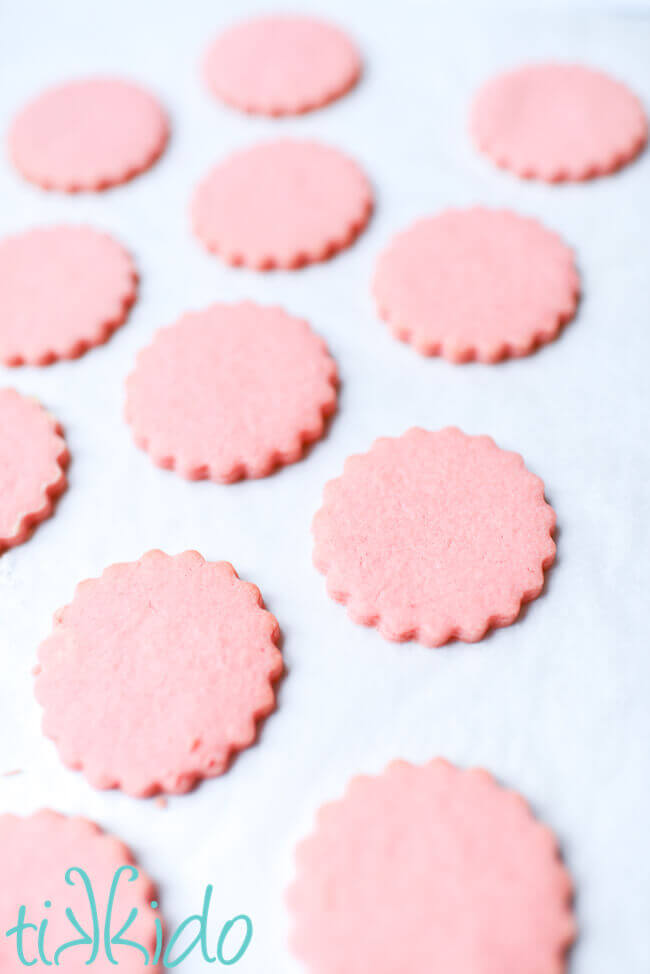 Cotton candy cookies baked on a parchment lined cookie sheet.