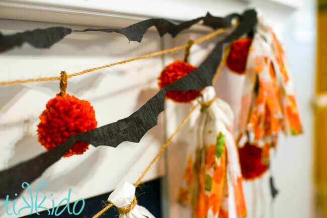 Tutorial for making a bat garland out of crepe paper for Halloween, including a free printable bat template.