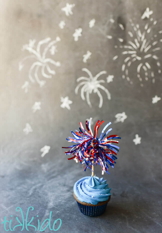 4th of July fireworks cupcake topper made out of shiny patriotic garland