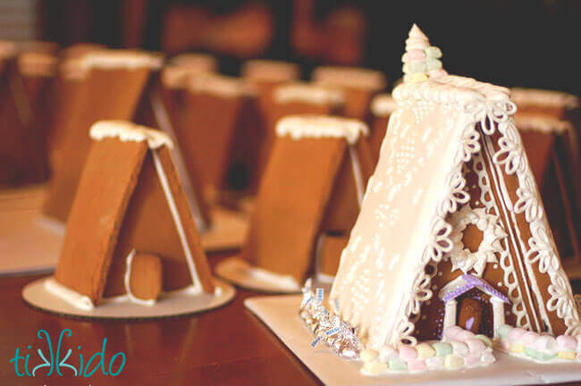Gingerbread houses assembled and decorated with royal icing.