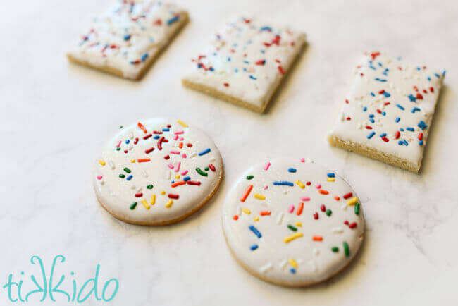 Sugar cookies dipped in royal icing and covered in sprinkles.