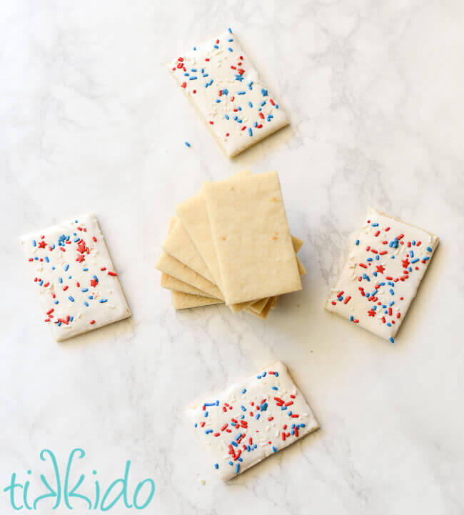 Sugar cookies coated in royal icing and covered in patriotic, red white and blue sprinkles.