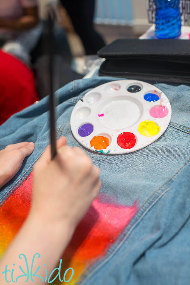 Denim jacket painting at a Culture Hustle workshop run by artist Jade Laurice.