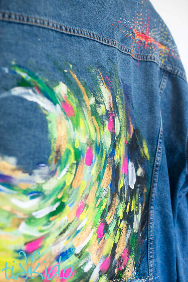 Abstract painted jean jacket design painted with acrylic paints.
