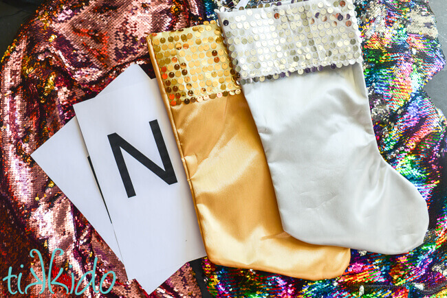 24347386216 Blank silver and gold Christmas stockings on mermaid sequin fabric and  monograms printed on paper.