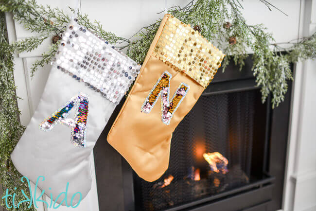 049316efecc Christmas stockings with mermaid sequin reversible fabric monograms on  silver and gold stockings on a white