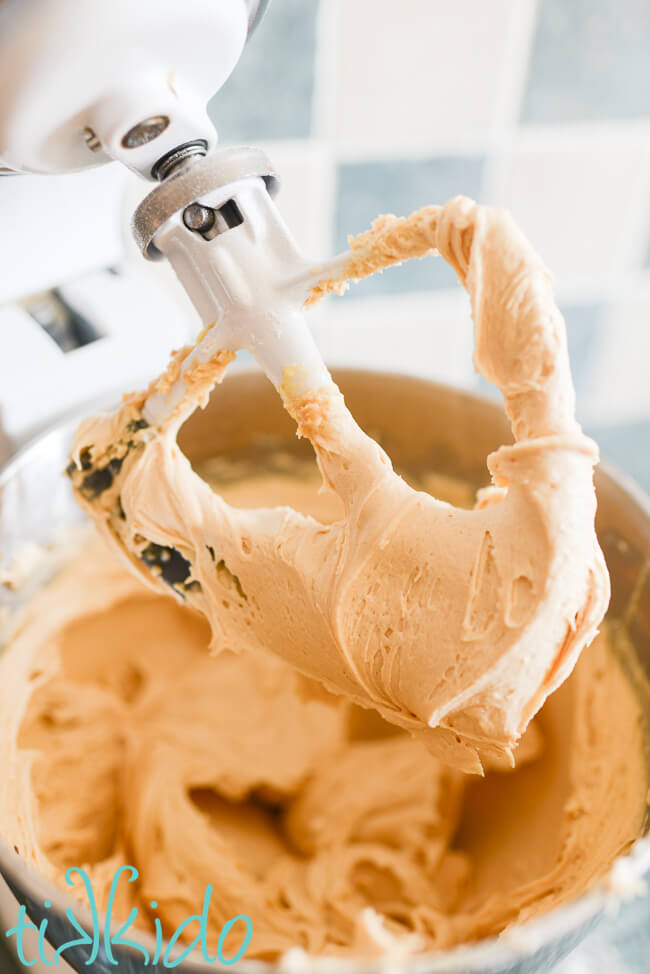 Peanut Butter Frosting being made in a Kitchenaid Mixer.