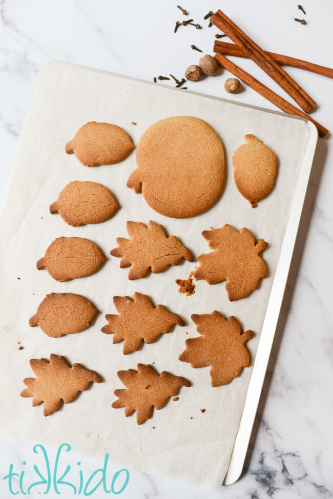 Freshly baked Pumpkin Spice Sugar Cookies on a parchment lined cookie sheet.