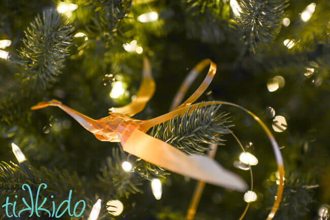 Golden Woven Ribbon Bird perched in a Christmas tree.