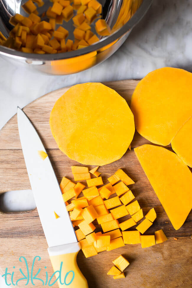 Fresh butternut squash, cut and ready to be roasted to make a butternut squash appetizer.