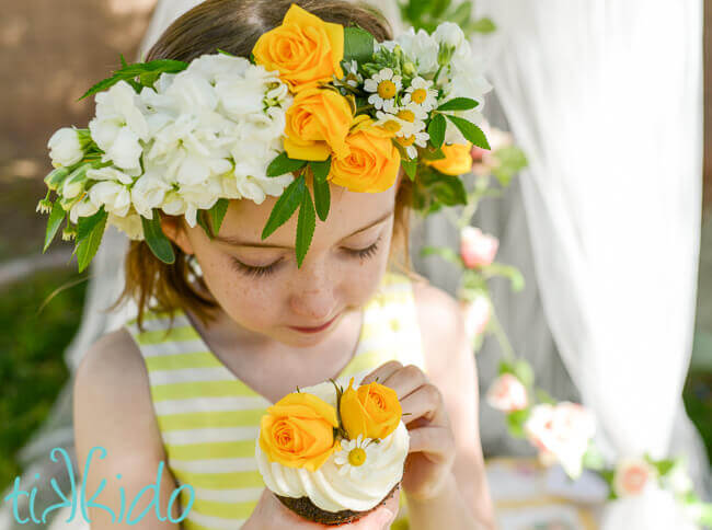 Easy diy fresh flower crown tutorial tikkido little girl wearing a yellow and white flower crown and holding a cupcake decorated with flowers mightylinksfo