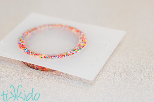 How to make a sprinkles resin bracelet using epoxy resin, sprinkles, and a bracelet mold.