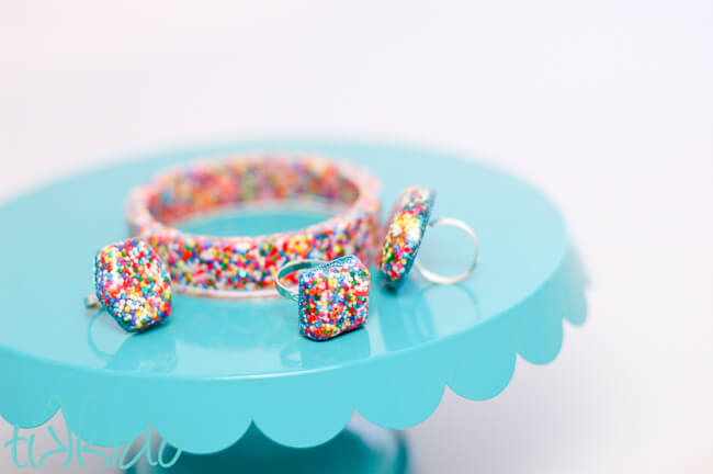 Resin jewelry filled with real sprinkles for favors for a sprinkles birthday party