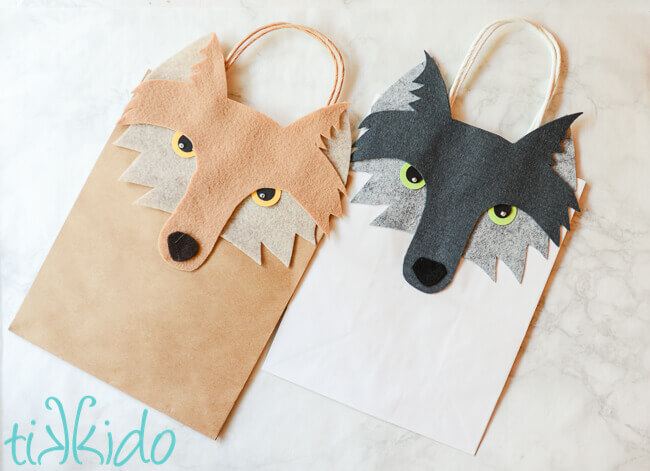 Two gift bags decorated with felt wolf faces