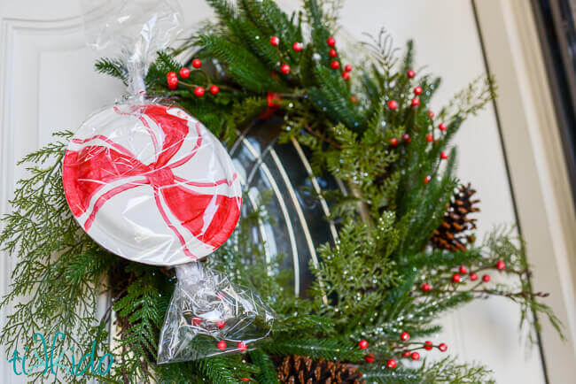 giant peppermint candy garland decorations tutorial easy inexpensive large scale peppermint decorations for christmas made from paper plates decorating a