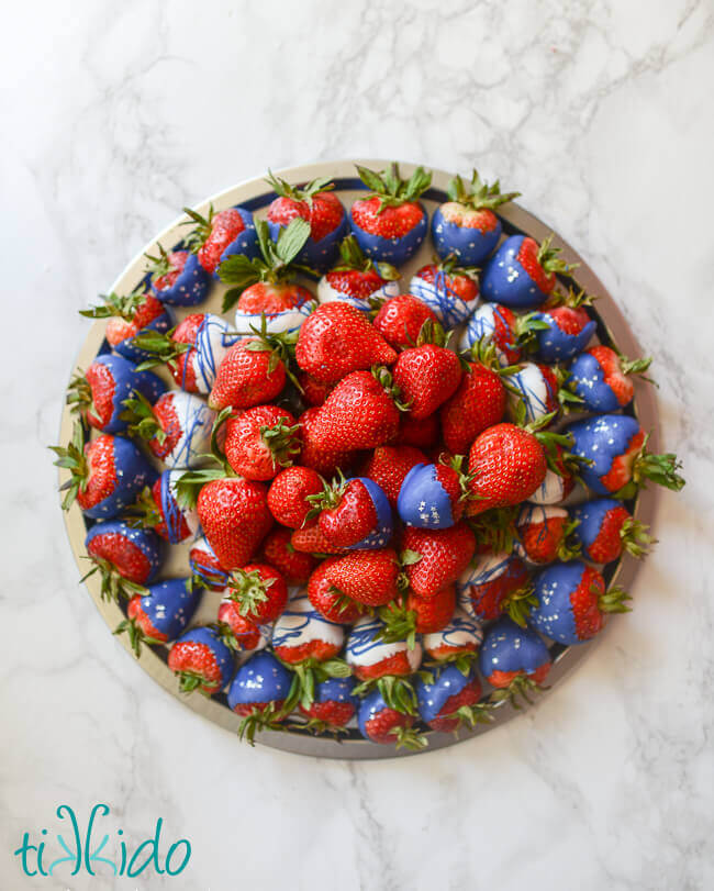 Patriotic red, white, and blue chocolate covered strawberry platter for Memorial Day and the 4th of July.