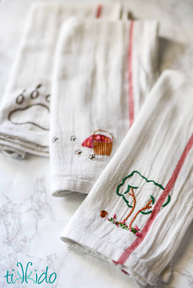 little red riding hood picnic and saw inexpensive plain white dish cloths at ikea and was immediately reminded of embroidered tea towels