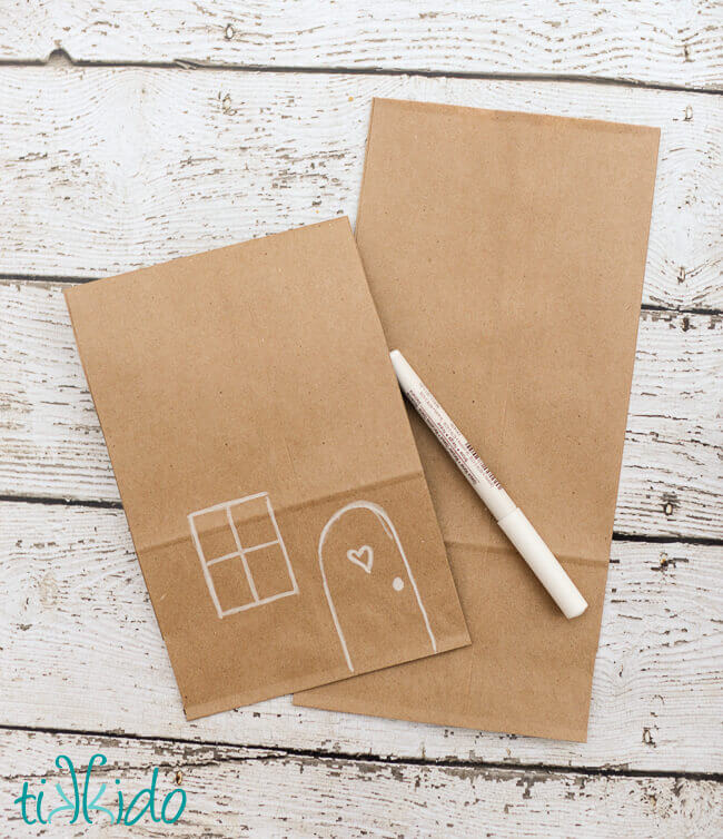 Use A White Paint Pen To Draw Simple Door And Window On The Front Of Brown Paper Lunch Bag Fold Top Few Inches Down